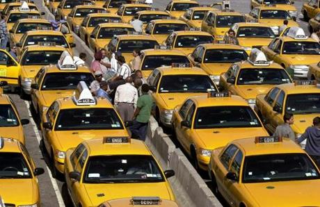 Taxis sit idle awaiting business at New York's LaGuadia Airport 17 September 2001. Taxis are feeling the impact of few passengers returning to air travel at one of New York's busiest airports as a result of passenger security concerns and the use of hijacked airliners by terrorists to attack New York and Washington 11 September. AFP PHOTO/Tannen MAURY Published in NYTimes 09/24/01 Photo Description: Taxis sit idle awaiting business at New York's LaGuadia Airport (REEFER) FOR BOSTONGLOBE.COM GALLERY ONLY!!!!!! airlinegallery